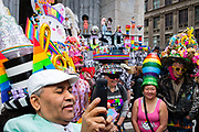 New York, NY - 21 April 2019. A crowd of people with LGBTQ hats on the steps of St. Patrick's Cathedral at the Easter Bonnet Parade and Festival on New York's Fifth Avenue.
