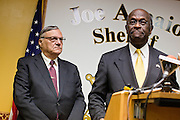 17 OCTOBER 2011 - PHOENIX, AZ:   Maricopa County Sheriff JOE ARPAIO with HERMAN CAIN, a Republican candidate for US President, during a press conference in Arpaio's office. Cain was in Phoenix to visit with Maricopa County Sheriff Joe Arpaio and was the featured speaker at a Republican party fundraiser.    PHOTO BY JACK KURTZ