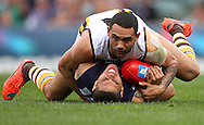 CATEGORY 5<br />Paul Kane<br />Getty Images<br />Shaun Burgoyne of the Hawks tackles Michael Walters of the Dockers during the round 21 AFL match.