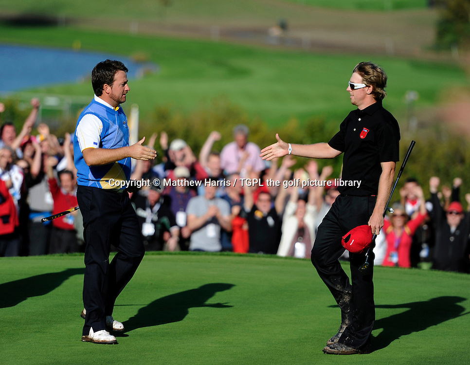 Moments after winning the point to give Europe victory,Graeme MCDOWELL (EUR) go's to  shake hands with Hunter MAHAN (USA) who he just beat 3 and 1 during Session_Four_Singles,Ryder Cup Matches,Celtic Manor Twenty Ten Course,Newport,Gwent,Wales.