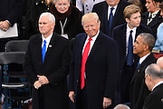 President Donald Trump smiles as he stands with Vice President Mike Pence before becoming the 45th President of the United States of America during the Presidential Inauguration on Capitol Hill January 20, 2017 in Washington, DC.