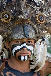 Mexico, Yucatan, Tulum, teenage boy dressed as ancient Mayan warrior