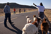Nelson Kotiar gives a thumbs-up of encouragement to Catholics making the return trip to Santa Rosa on the 10-mile march between St. Rose of Lima Church in Santa Rosa and Nuestra Seniora del Refugio Church. The Kotiar group included two dogs and two goats, one of which is pregnant. At left is Nelson's daughter Anamika Kotiar, age 14.