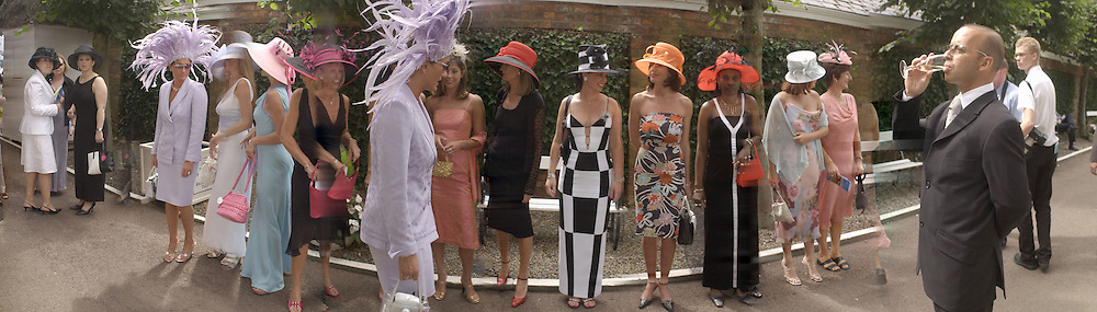Shortlisted contestents in the 'Best dressed lady racegoer' competition sponrored by McArthur glen designer outlet. Lady in purple big hat is Rebecca Shaw. Hat by Adele by Eleida Hats, W. yorks. <br /> <br /> York races, Tote Ebor, August meeting. Ladies day. Victor Chandler Nunthorpe Stakes. 22 August 2002. © Copyright Photograph by Dafydd Jones 66 Stockwell Park Rd. London SW9 0DA Tel 020 7733 0108 www.dafjones.com