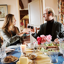 Claudia di Paolo and Xavier Desforges enjoying a glass of wine and traditionally french plates of cheeses and charcuterie, at lunch with Maison Caulieres. Dolus-le-Sec, France. October 7, 2019.