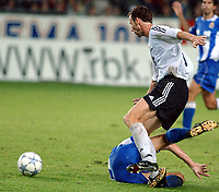 Champions League, 13. August 2003, <br />Rosenborg - Deportivo La Coruna 0-0,<br />Christer Basma playing physical soccer at the expence of Jose Amausca<br /><br />Photo: Carl-Erik Eriksson, Digitalsport