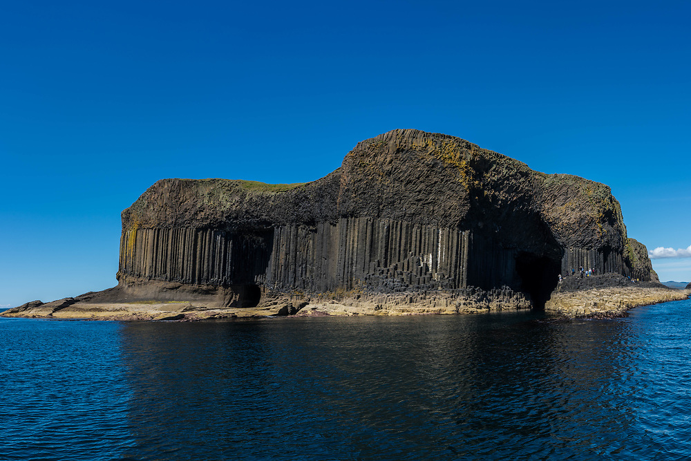 Columnar jointing of staffa gives it that unique look.  This is the Fingal's cave of Mendelsshn's Overture.