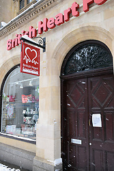 Snow, Norwich Feb 2018 UK. British Heart Foundation shop closed due to the weather
