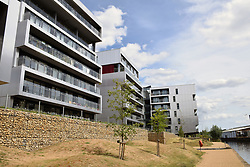 New housing developments on bank of River Wensum, Norwich UK 2017.  On the left is Broadland Housing's Brennan Bank, one of 60 high and mid-rise buildings across 25 local authority areas in England that the government said has failed safety tests in the wake of the Grenfall Tower disaster in London. June 2017 UK