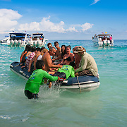 Tourists leaving Ko Miang on inflatable boa, Similan islands, Thailand