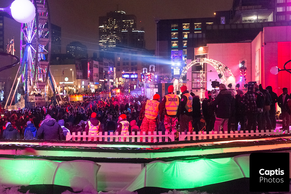 Police watch over a crowded street of revellers during Nuit Blanche. February 28, 2016 Brendan Montgomery/Captis Photos