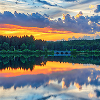 Quinepoxet River Bridge in West Boylston of Central Massachusetts on a beautiful sunset evening. New England colors photography of the historic landmark reflecting in the Wachusett Reservoir. <br /> <br /> Massachusetts West Boylston Quinepoxet River Bridge photography pictures are available as museum quality photo, canvas, acrylic, wood or metal prints. Wall art prints may be framed and matted to the individual liking and interior design decoration needs:<br /> <br /> https://juergen-roth.pixels.com/featured/quinepoxet-river-bridge-juergen-roth.html<br /> <br /> <br /> Good light and happy photo making!<br /> <br /> My best,<br /> <br /> Juergen