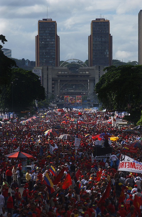 Thousands of supporters of President Hugo Chavez march through Caracas in celebration of the 5th anniversary of Chavez's presidency.  Opposition to Chavez held a petition drive seeking a referendum on his rule last week and results of that drive are expected in early January.