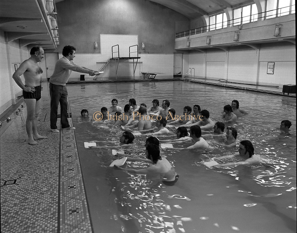BIM Swimming Lessons For Fishermen..1972..27.05.1972..05.27.1972..27th May 1972..After a recent spate of of accidents at sea where several fishermen had drowned B.I.M.instituted a programme of swimming lessons.Skippers and crews from around the country were encouraged to take part in the hope that safety at sea would improve..Image of instructor,Seamus Waters instructing the learners in the use of the float,also on the bank is Mr Brendan O'Kelly chairman of BIM.