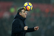Swansea city manager Carlos Carvalhal heads the ball on the touchline and gets a wet face during the Premier league match, Swansea city v Tottenham Hotspur at the Liberty Stadium in Swansea, South Wales on Tuesday 2nd January 2018. <br /> pic by  Andrew Orchard, Andrew Orchard sports photography.