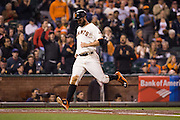 San Francisco Giants first baseman Brandon Belt (9) scores a run against the Colorado Rockies at AT&T Park in San Francisco, Calif., on September 27, 2016. (Stan Olszewski/Special to S.F. Examiner)