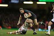 Hallam Amos of Wales © is tackled by Georgia' s Merab Sharikadze. Under Armour 2017 series Autumn international rugby, Wales v Georgia at the Principality Stadium in Cardiff , South Wales on Saturday 18th November 2017. pic by Andrew Orchard, Andrew Orchard sports photography