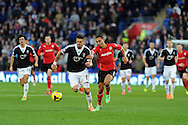 Southampton's Jose Fonte (6) holds off Cardiff city's Peter Odemwingie. Barclays Premier league, Cardiff city v Southampton at the Cardiff city Stadium in Cardiff,  South Wales on Boxing day, Thursday 26th Dec 2013. <br /> pic by Andrew Orchard, Andrew Orchard sports photography.
