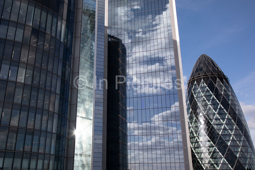 Views of the cityscape skyline looking towards 1 St Mary Axe aka the Gherkin from The Garden at 120, theCity of London's largest rooftop public space, located atop the newly opened Fen Court office building at 120 Fenchurch Street in London, United Kingdom. At 15-storeys up, the viewing platform offers exceptional 360-degree views of the City and greater London, and is free for members of the public to visit.