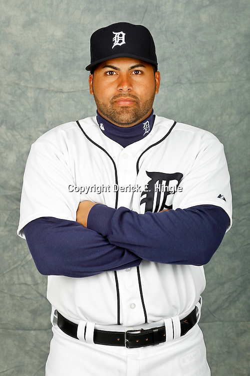 February 28, 2012; Lakeland, FL, USA; Detroit Tigers catcher Omir Santos (67) poses for photo day in the rec room at the Detroit Tigers Headquarters.  Mandatory Credit: Derick E. Hingle-US PRESSWIRE