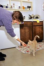 Jean Pendleton Feeding Cat By Hand