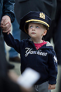 Goshen, New York - A young boy wears a police officer's hat during the Orange County Law Enforcement Officer Memorial Service on May 2, 2014. The memorial service honors the memory of the 27 members of the Orange County law enforcement community that died in the line of duty. The service also pays tribute the families and loved ones left behind for their courage, dignity and perseverance.