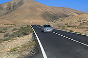 Tarmac road crossing desert, Fuerteventura, near Pajara, Canary Islands, Spain