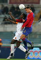 Fotball<br /> UEFA Cup<br /> 14.12.2005<br /> Roma v Basel 3-1<br /> Foto: Graffiti/Digitalsport<br /> NORWAY ONLY<br /> <br /> FC Basel Reto Zanni and As Roma Shabani Nonda