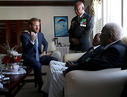 Prince Harry meets veterans during a visit to Camp Ayanganna, the headquarters of the Guyana Defence Force, in Georgetown, Guyana, after arriving in the South American country on the final stop of his 15-day tour of the Caribbean.