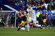 Tranmere Rovers' Ash Taylor ® and Notts County's Ronan Murray battle for the ball. Skybet football league one match, Tranmere Rovers v Notts county at Prenton Park in Birkenhead, England on Saturday 15th March 2014.pic by Chris Stading, Andrew Orchard sports photography