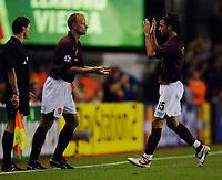 Photo: Henry Browne.<br /> Arsenal v FC Thun. UEFA Champions League.<br /> 14/09/2005.<br /> Supersub Dennis Bergkamp replaces Cesc Fabregas of Arsenal.