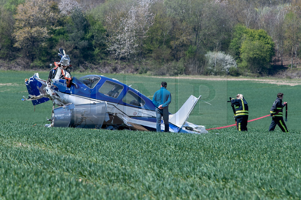 © Licensed to London News Pictures. 26/04/2021. High Wycombe, UK. A damaged plane in a field following a crash at Wycombe Air Park, also known as Booker Airfield. the incident occurred at approximatly 10:30 BST when the plane crashed through bushes at the end of the runway coming to rest in a field. Photo credit: Peter Manning/LNP