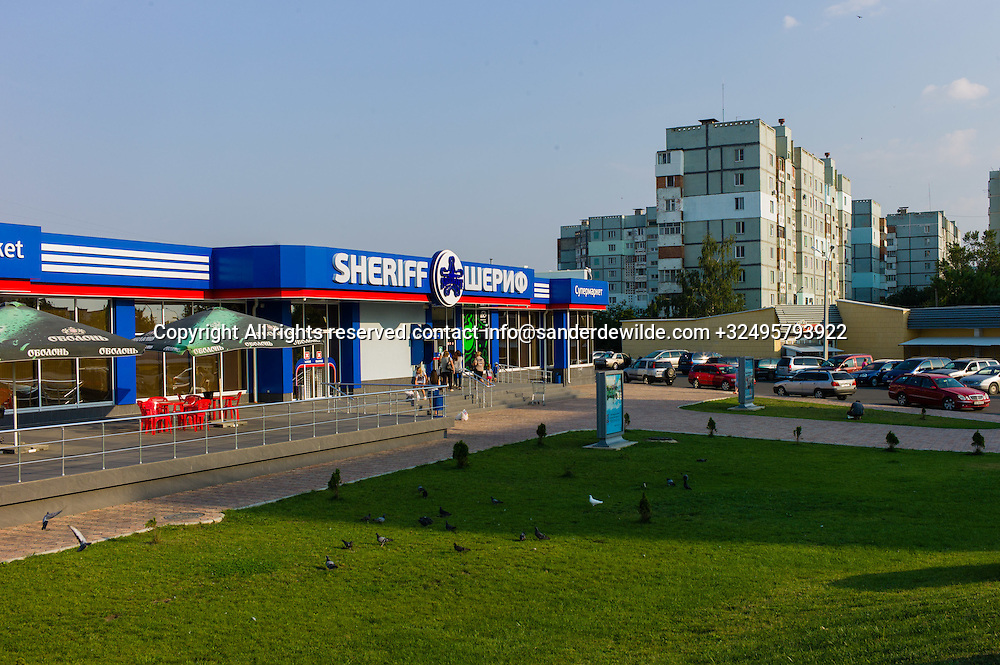 20150828  Moldova, Transnistria,Pridnestrovian Moldavian Republic (PMR) Tiraspol. One of the many Sheriff supermarket spread around town everywhere. The sheriff concern almost is a monopolist in the country and the luxury contrasts with the gloomy appartment buildings around it.