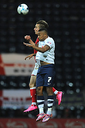 Joe Bryan of Bristol City challenges for the header with Chris Humphrey of Preston North End - Mandatory byline: Dougie Allward/JMP - 07966386802 - 15/09/2015 - FOOTBALL - Deepdale Stadium -Preston,England - Bristol City v Preston North End - Sky Bet Championship