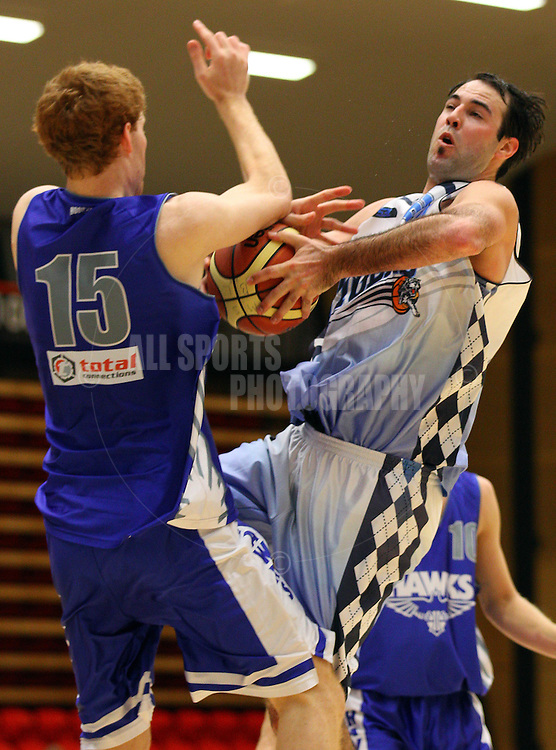 PERTH, AUSTRALIA - JULY 16: Mark Jones of the Tigers drives to the basket against Andy Burns of the Hawks during the week 18 SBL game between the Perry Lakes Hawks and the Willetton TIgers at The State Basketball Center on July 16, 2011 in Perth, Australia.  (Photo by Paul Kane/Allsports Photography)