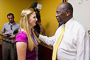 17 OCTOBER 2011 - PHOENIX, AZ:   OLIVIA BROWN, from Anthem, AZ, talks to HERMAN CAIN, a Republican candidate for US President after a press conference at the Maricopa County Sheriff's Office in Phoenix, AZ, Monday. Cain was in Phoenix to visit with Maricopa County Sheriff Joe Arpaio and was the featured speaker at a Republican party fundraiser.   PHOTO BY JACK KURTZ