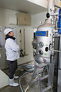 A worker checks the reading on the still at the Nekka Shochu Distillery, Tadami, Fukushima, Japan, February 20, 2018. The Nekka shochu distillery was founded in July 2016 and at that time was the smallest shochu distillery in Japan. It makes shochu from locally-grown rice, and is helping support a local economy that has languished since the nuclear disaster of 2011.