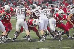 This is a PHOTO ILLUSTRATION.  Filters have been applied.<br /> <br /> 25 September 2010: Nick Bledsoe, Nathan Rebholz, and Chris Riley work to hold back Waylon Richardet, Mikel Ruder, and Terian Washington on a point after kick attempt.   The Missouri State Bears lost to the Illinois State Redbirds 44-41 in double overtime, meeting at Hancock Stadium on the campus of Illinois State University in Normal Illinois.