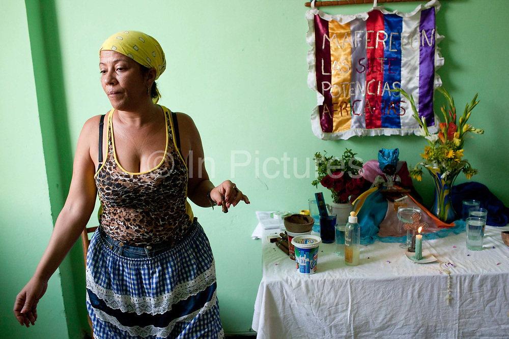 Santeria is not regarded as an official religion by the state, and therefore has no official places of worship, the ceremonies are carried out in the houses of the Santeros. It is a syncretic religion practiced in Cuba, it is a mixture of Yoruba tribal practices brought from Nigeria during Colonial times, and traditional Catholic beliefs. During this time, the slaves used the images of saints to cover up their worship of the Orishas (spirits).