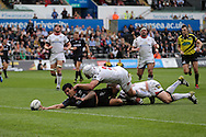 Josh Matavesi of the Ospreys stretches over for his teams 2nd try despite the attention of Ulster's Rory Best and Callum Black. Guinness Pro12 rugby match, Ospreys v Ulster Rugby at the Liberty Stadium in Swansea, South Wales on Saturday 7th May 2016.<br /> pic by  Andrew Orchard, Andrew Orchard sports photography.