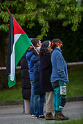 Leicester, United Kingdom, May 19, 2021: People hold and wave a Palestinian flag outside Elbit UAV Tactical Systems factory, In response to Israeli air raids in Gaza, activists from Palestine Action occupied the rooftop of the Meridian Business Park in Braunstone Town, Leicester on Wednesday, May 19, 2021. (Photo by Vudi Xhymshiti/VXP)