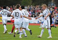 Fotball NM Cup Stjørdalsblink - Rosenborg<br /> Øverlands Minde, Stjørdal 13 mai 2010<br /> <br /> Morten Moldskred gratulerer Trond Olsen med 2-0-scoringen<br /> <br /> Foto : Arve Johnsen, Digitalsport