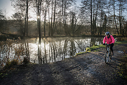 © Licensed to London News Pictures. 02/01/2017. Godalming, UK. A cyclist braves the early morning cold next to the River Wey near Godalming. A cold spell is expected to remain for most of the next week. Photo credit: Peter Macdiarmid/LNP