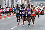 """Ethiopian runner, Markos Geneti (No 6) leads the elite runners, including  Stephen Kiprotich (No 3), Dickson Chumba (No 4) and Shumi Dechasa (No 8) in the Tokyo marathon in Ginza, Tokyo, Sunday February 22nd 2015 The Tokyo marathon celebrated its ninth race in 2015 and has obtained """"Gold Label"""" ranking from IAAF putting it in the World Marathon Majors league."""