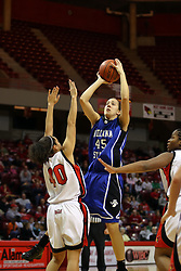 19 January 2008: Ashleen Bracey stands in and forces a shot by Laura Rudolphii.  Both the Indiana State Sycamores and the Illinois State Redbirds came to this game tied for 1st place and defeated in the Missouri Valley Conference.  The Redbirds in their 11th consecutive game 77-70 on Doug Collins Court inside Redbird Arena in Normal Illinois