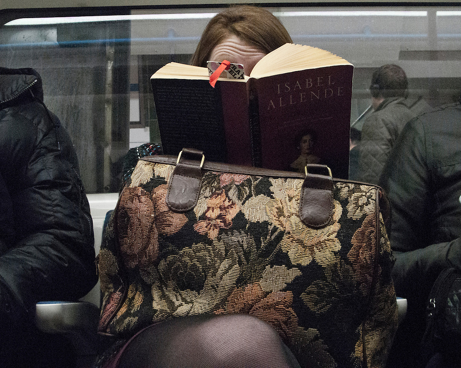 Female on the London Underground Network reading a book