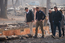 November 17, 2018 - Paradise, California, U.S. - President DONALD TRUMP,  FEMA Director BROCK LONG, Gov. JERRY BROWN, Gov.-elect GAVIN NEWSON and Paradise mayor JODY JONES tour the Skyway Villa Mobile Home and RV Park during his visit of the Camp Fire in Paradise. The Camp Fire in Northern California has become the nation's deadliest wildfire in a century and has killed at least 63 people and left more than 1000 still missing. (Credit Image: © Paul Kitagaki Jr./ZUMA Wire)
