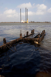 25 Sept, 2005.  Lake Calcasieu, Louisiana. Hurricane Rita aftermath. <br /> An oil platform support vessel slips out to sea as an oil spill ebbs into the channel from a ruptured pipeline close by.<br /> Photo; ©Charlie Varley/varleypix.com