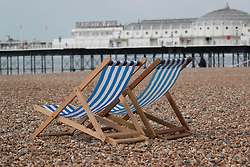 © Licensed to London News Pictures. 31/05/2014. Brighton, UK. A deck chair for hire on Brighton Beach. The weekend is expected to reach temperatures of 20C down the South Coast according to the MET office. Photo credit : Hugo Michiels/LNP