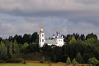 A new church glistens in the late afternoon light on the banks of the Rybinsk Reservoir. The Volga-Baltic Waterway, made up of natural lakes, rivers, reservoirs, and canals, runs from St. Petersburg to Moscow, Russia, a journey of 700 miles.